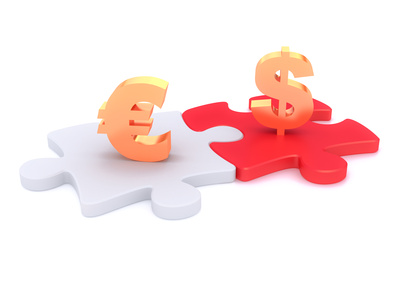 Euro and dollar symbols on puzzle peaces